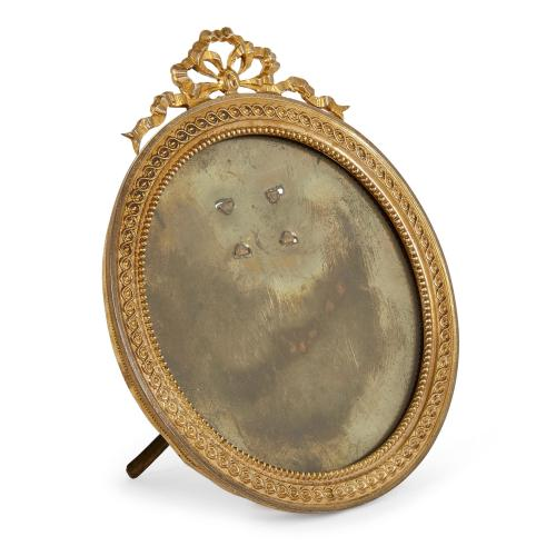 French Empire style circular ormolu picture frame