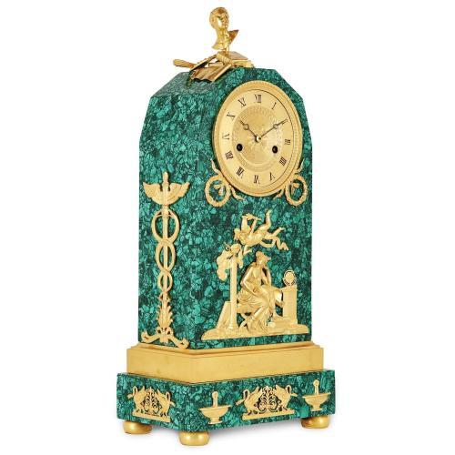 French Empire period ormolu and malachite mantel clock