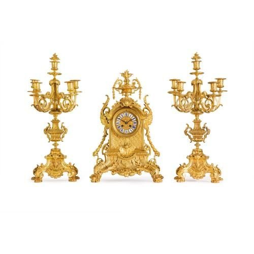 Neo-Gothic antique three piece ormolu clock set
