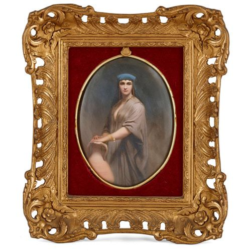 Oval KPM porcelain plaque depicting a lady with a pitcher