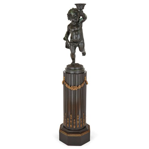 Large antique patinated bronze cherub figure on pedestal