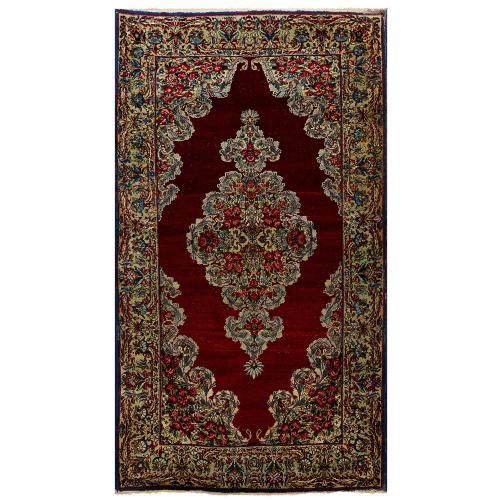 Antique Kirman woven wool Persian rug