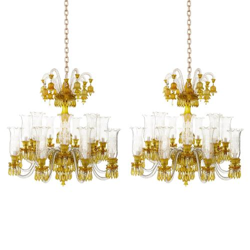 Pair of yellow and clear crystal twelve-light chandeliers
