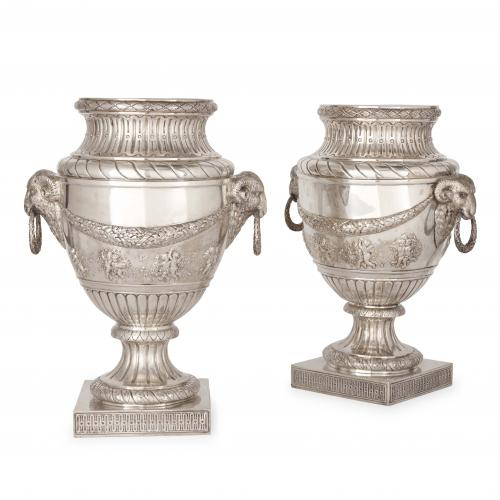 Large pair of antique silver vases