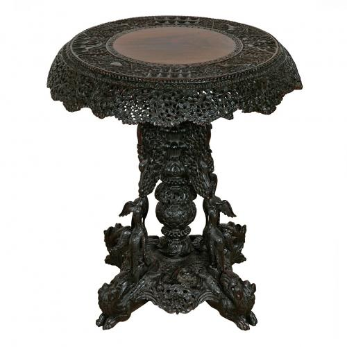 A Burmese hardwood circular occasional table