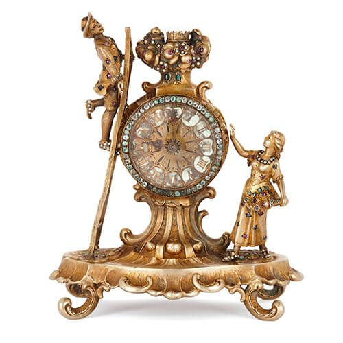 Antique Viennese silver gilt and precious stone table clock
