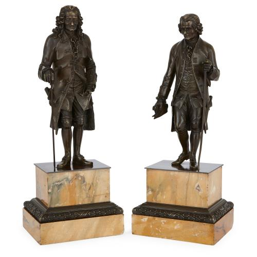 Pair of antique bronze sculptures of Rousseau and Voltaire