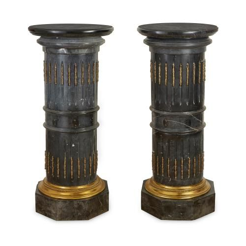 Pair of ormolu mounted black marble antique pedestals