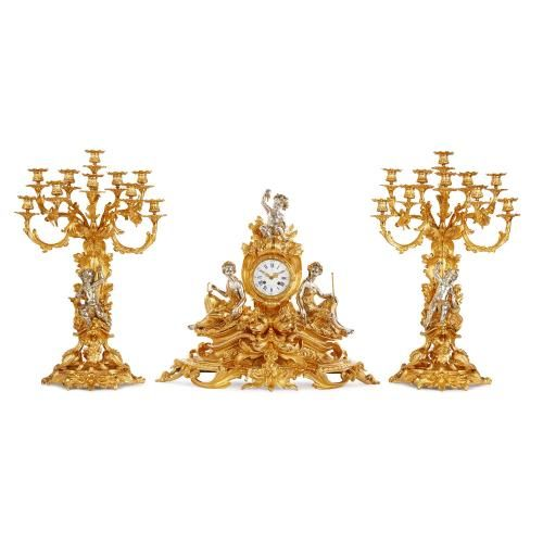 Large silvered and gilt bronze three piece clock set