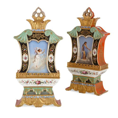 Pair of French porcelain and parcel gilt antique vases