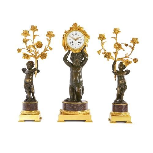 Porphyry and bronze French antique clock set by Dasson
