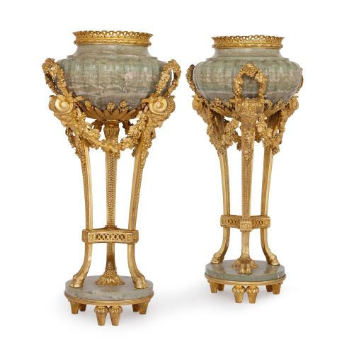 Pair of ormolu mounted Connemara marble urns after Gouthière