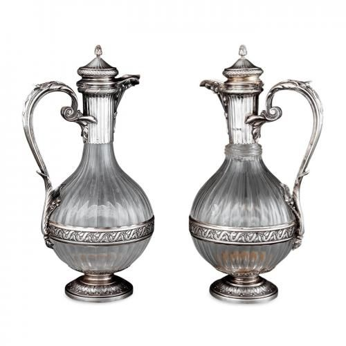 Pair of silver mounted crystal claret jugs by Boin-Taburet
