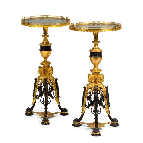 A pair of gilt and patinated bronze gueridons with malachite tops