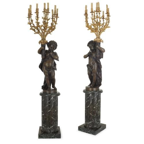 Pair of large French gilt and patinated bronze antique torcheres