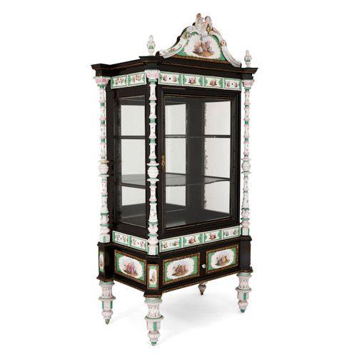 K.P.M. porcelain and ormolu mounted ebonised wood vitrine