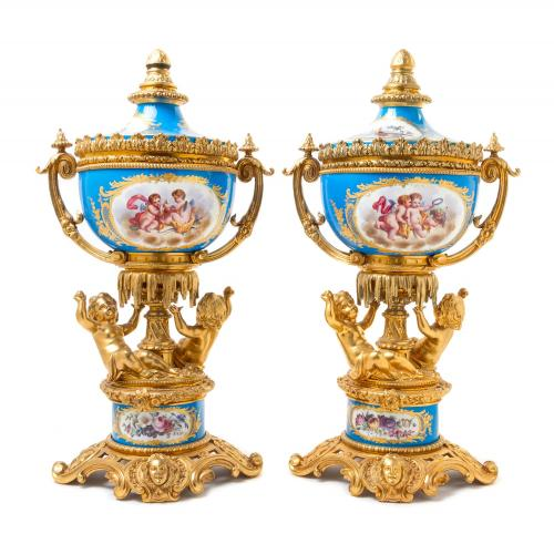 A pair of ormolu mounted Sèvres style porcelain vases