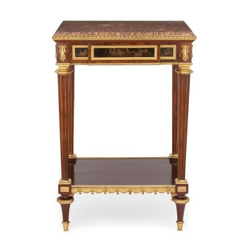 Ormolu mounted mahogany occasional table by Henry Dasson