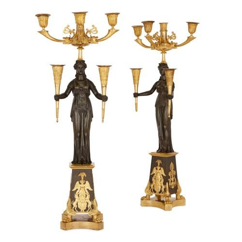Two Empire period gilt and patinated bronze candelabra