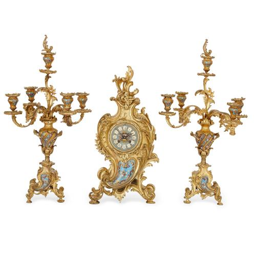 Rococo style champleve enamel and ormolu three piece clock set