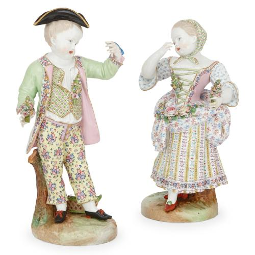 Pair of large antique Meissen style porcelain figures