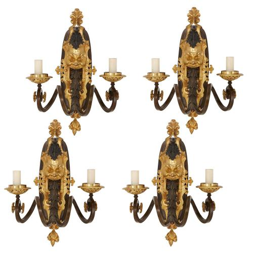 Set of four antique gilt and patinated bronze wall lights