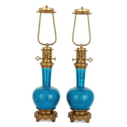 Pair of Persian style ormolu and blue faience lamps by Deck