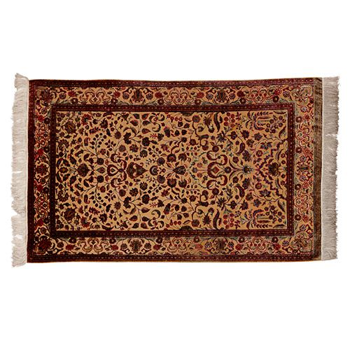 Persian fringed silk rug with brightly-coloured floral motifs