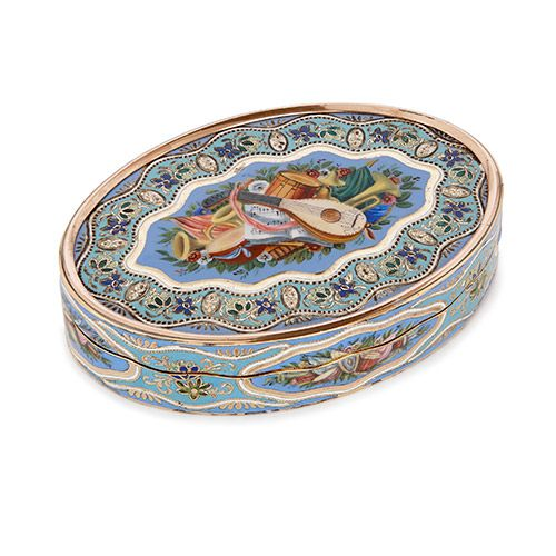 Swiss gold and enamel snuff box with music themed decoration