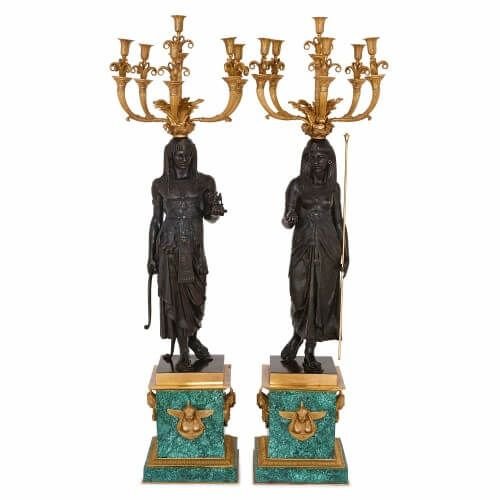 Pair of Egyptian style bronze candelabra on malachite bases