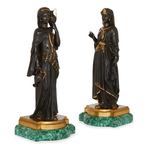 Pair of patinated bronze Egyptian figures on malachite bases