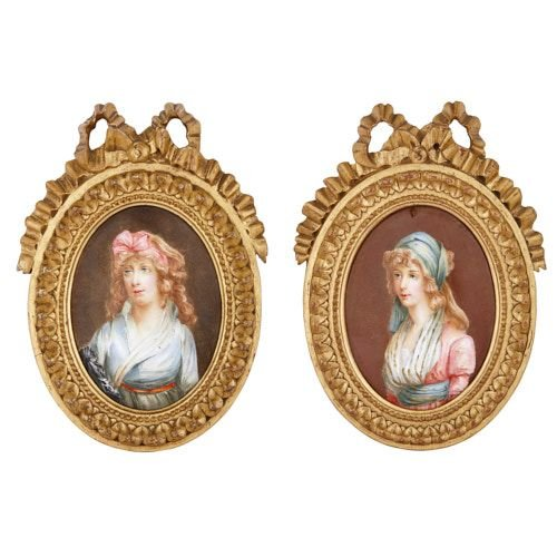 Pair of antique Limoges enamel portraits in giltwood frames