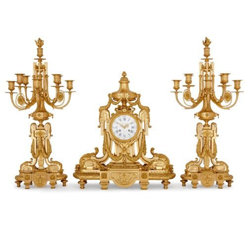 Antique Louis XV style ormolu clock set by Royer