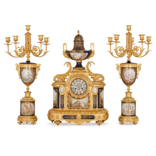 An ormolu and Sèvres style porcelain three piece clock set
