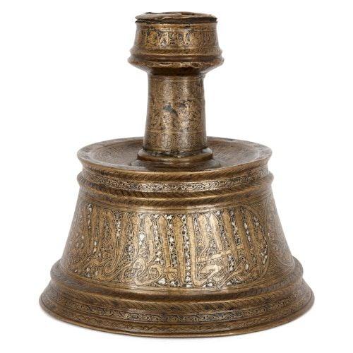 Mamluk gold and silver inlaid brass candlestick