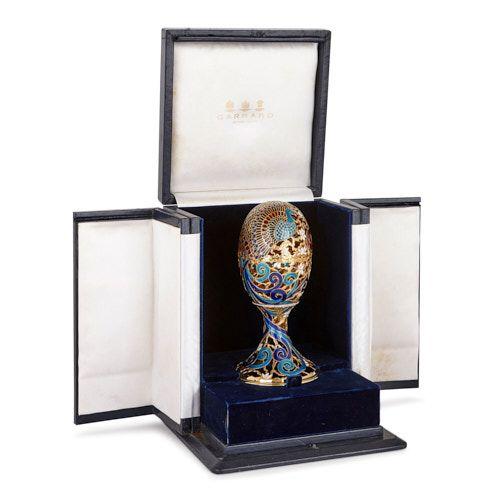 Gold, enamel, diamond and precious stone egg by Asprey