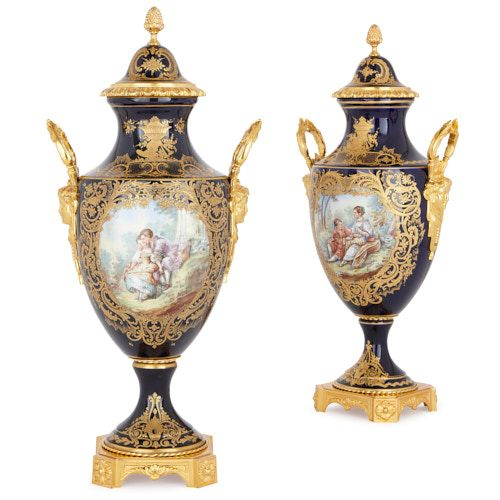Pair of ormolu mounted porcelain vases with courtship scenes