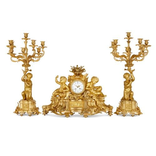 Rococo style ormolu clock set by Picard and Raingo Frères