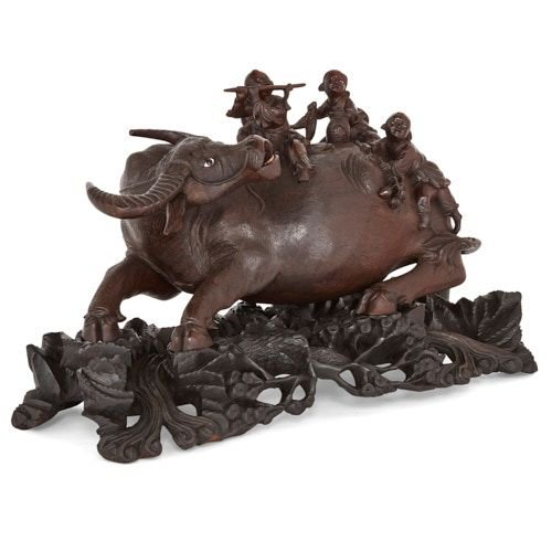 Chinese hardwood carved sculpture group of a cow