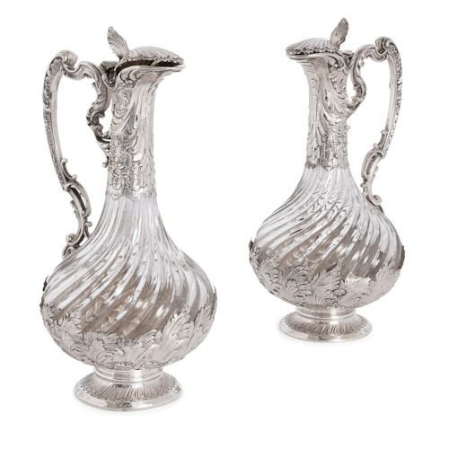 Pair of French silver and crystal claret jugs