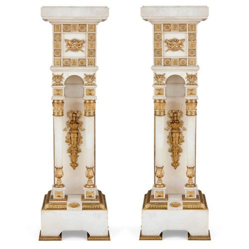 Pair of French white marble and ormolu pedestals