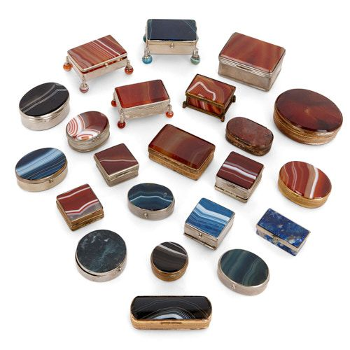 Twenty-two silvered and gilt metal mounted agate pill boxes