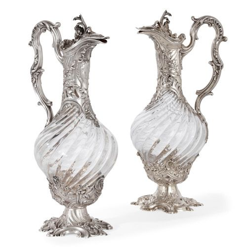 Pair of silver and crystal claret jugs by Victor Boivin