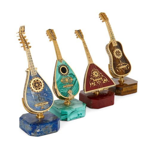Set of semi-precious stone and silver-gilt miniature instruments