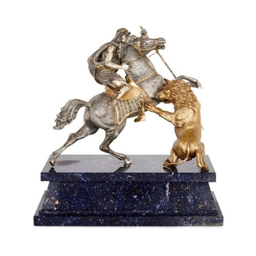 Italian silver and silver-gilt group of a rider, horse and lion
