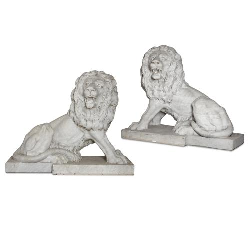 Pair of large Italian sculptural marble lions