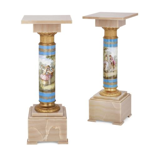 Pair of Sèvres style porcelain and onyx pedestals