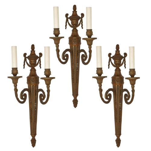 Set of three Neoclassical style patinated metal wall lights