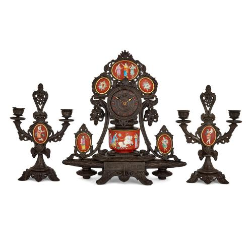 French porcelain and cast iron Neo-Grec three-piece clock set