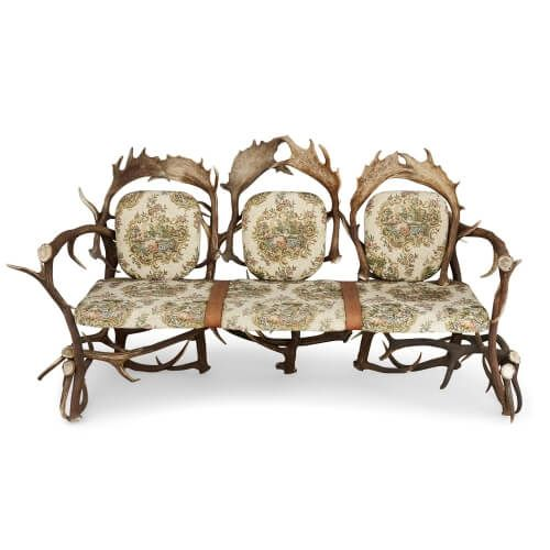 German antler sofa with upholstered cushions